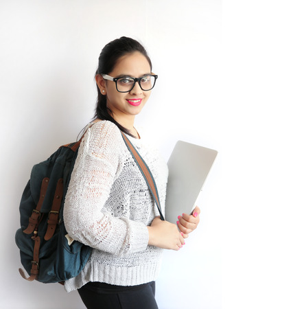 Photo pour A Young Beautiful Indian College Student Holding Laptop on Isolated White Background - image libre de droit