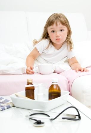 sick litttle girl  on bed