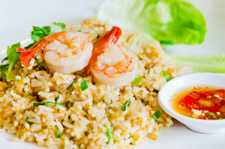 fried rice and shrimp  served with spicy sauce and fresh vegetable