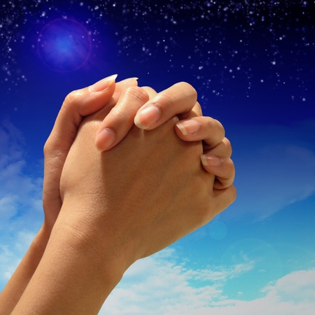 Prayer Hand to above night sky background