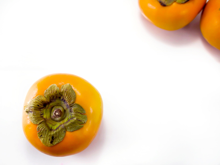 Isolated persimmon fruit on the white background