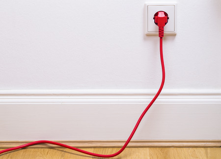 Interior outlet with a red cable plugged in