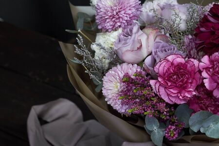 Photo for Pink and purple toned bouquet in vintage style on dark background, selective focus - Royalty Free Image