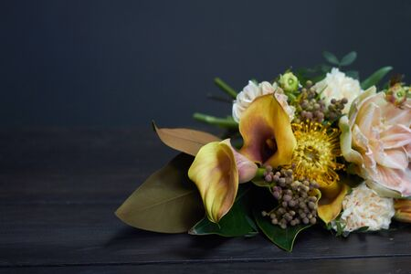 Naked bouquet in vintage style on dark background, selective focus