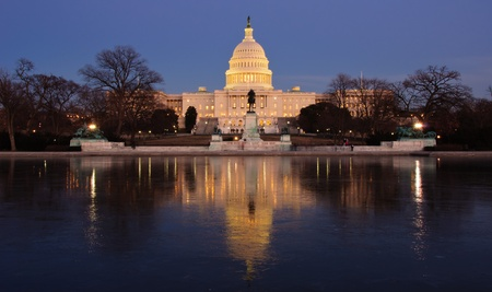 Icy reflection and the U.S. Capitol at sunset. Washington, DC