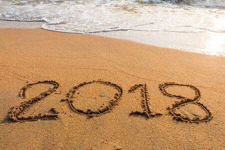 Photo pour abstract  2018  on a beach sand  background - image libre de droit