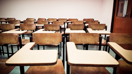 Old scattered chairs in the classroom