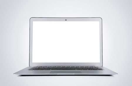 Foto de Blank modern laptop isolated on gray background with clipping path for the screen - Imagen libre de derechos