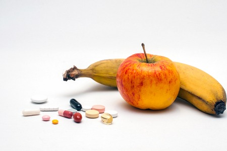 different colored tablets, apple and banana, isolated