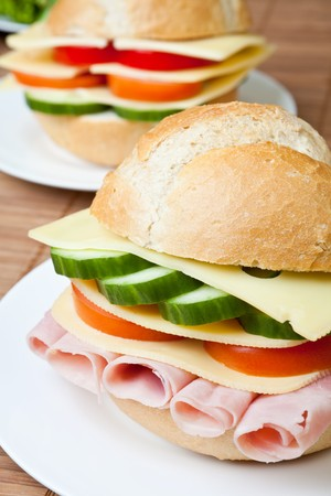 Delicious ham, cheese and salad sandwich on a plateの写真素材