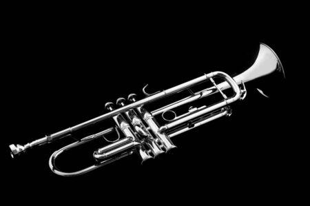 Silver trumpet on black background