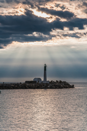 Photo for Lighthouse of Port-La-Nouvelle in red and white on cloudy sky in Occitanie, France - Royalty Free Image