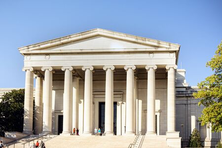 Photo pour Washington D.C., USA. October 2016: west building of the National Gallery of Art with tourists on the stairs on a sunny day in Washington D.C. - image libre de droit