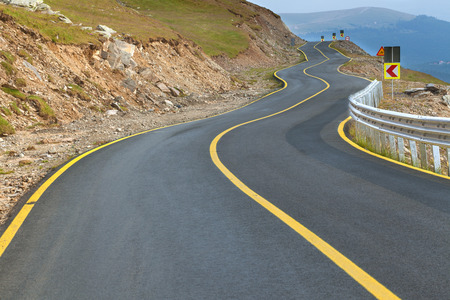 Transalpina zig zag road at day, highest and most dangerous asphalt road in Romania.
