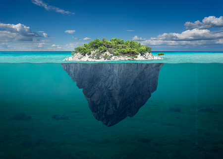 Foto de Idyllic underwater view of lone small island above and below the water surface in turquoise waters of tropical ocean. - Imagen libre de derechos