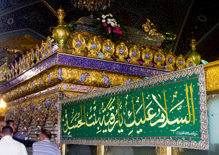 Internal picture of the tomb of Lady Rqiah in DamascusWhich show some visitors Embroidered and a golden cage represents her grave.