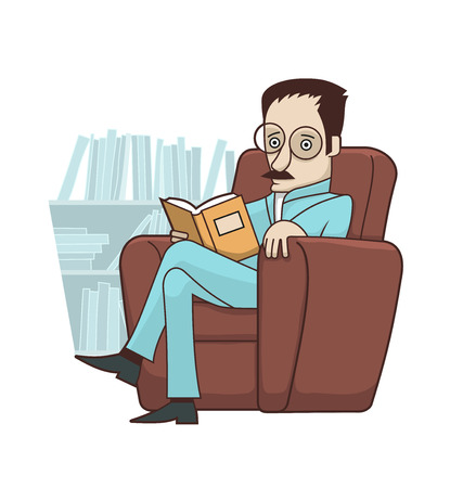 Man reading book sitting in armchair in his study room. There are several bookshelves in the background.