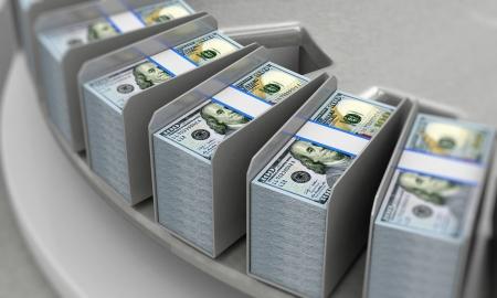 New 100 Dollar Bills on a Conveyor