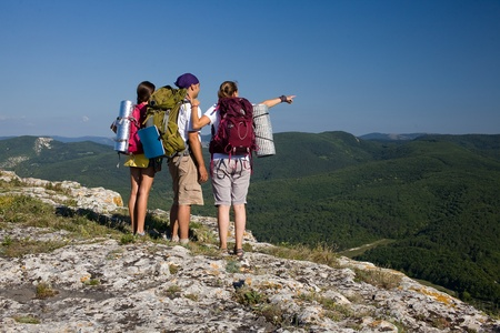 Group of three tourists discover