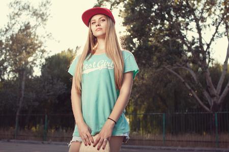 Teen model posing with skateboard