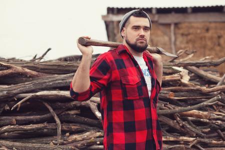 Stylish young man posing like lumberjack