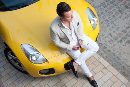 Photo pour Stylish young man posing with sport car - image libre de droit