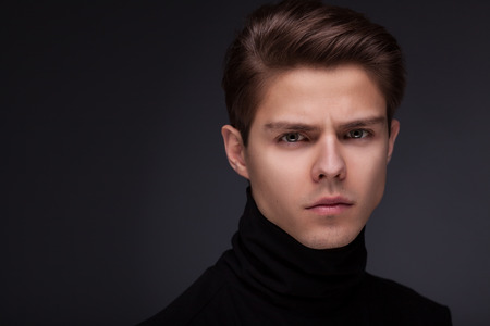 Photo pour Stylish guy close up portrait on black background - image libre de droit