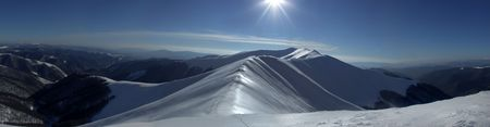 Panoramic picture of Carpathian mountain range named Vysokiy Verh