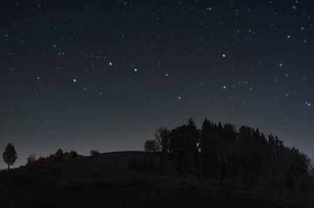 Photo for A picture of the starry night sky with Ursa Major constellation over the hill - Royalty Free Image