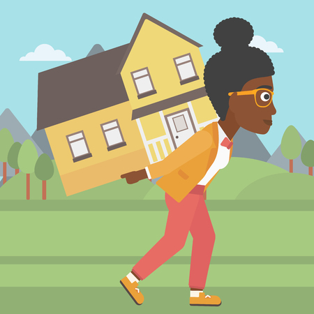 Illustration for An african-american young woman carrying a big house on her back on the background of mountains. Vector flat design illustration. Square layout. - Royalty Free Image