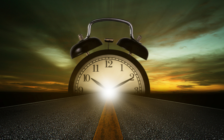 Foto de Time management concept, road and alarm clock on sky background - Imagen libre de derechos