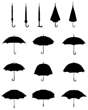 Foto de Black silhouettes of open and closed umbrellas, vector - Imagen libre de derechos