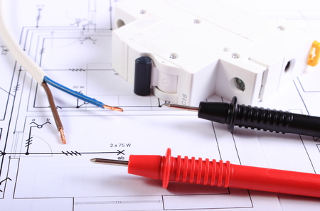 Photo pour Cables of multimeter, electric wire and electric fuse on construction drawing, electrical drawings and tools for engineer jobs - image libre de droit