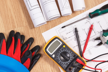 Photo pour Electrical construction drawings or diagrams, multimeter for measurement in electrical installation and accessories for use in engineer jobs - image libre de droit