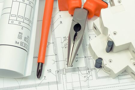 Photo for Electrical diagrams, electric fuse and work tools on construction drawing of house. Building home concept. Drawings for projects engineer jobs - Royalty Free Image