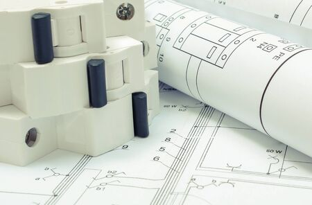 Photo pour Electrical diagrams and electric fuse on construction drawing of house. Concept of building home - image libre de droit