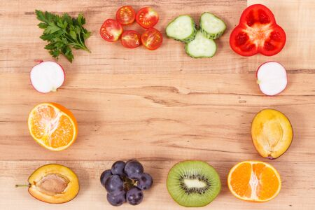 Photo for Frame of fresh healthy nutritious fruits and vegetables as source vitamins, dietary fiber and minerals, place for text or inscription - Royalty Free Image
