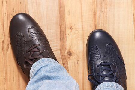 Photo pour Elegant stylish comfortable navy blue and brown shoes for men on board - image libre de droit