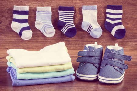 Photo pour Clothing for newborn, concept of expecting for baby and extending family.Vintage photo - image libre de droit