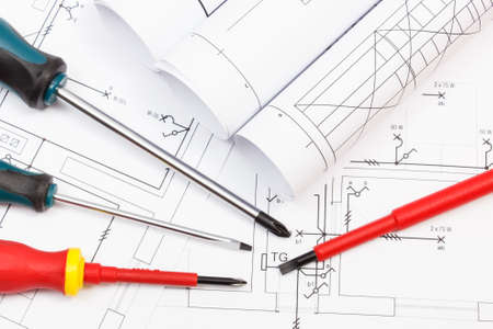 Photo pour Screwdriver and diagrams of housing plan with electrical installation. Building home concept - image libre de droit