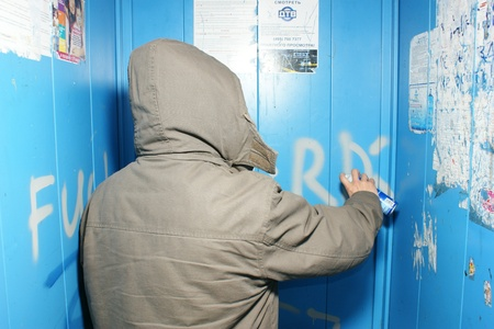 MOSCOW - MART 12: The vandal paints indecent words in the apartment house lift