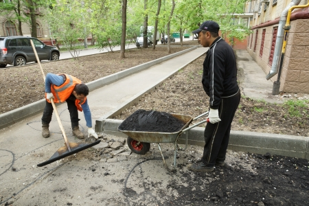 14_05_2012 Moscow, Russia. Road workers repair an asphalt covering