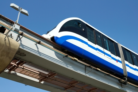monorail train against the dark blue sky