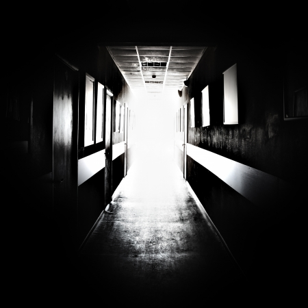 Black corridor with bright light in the end