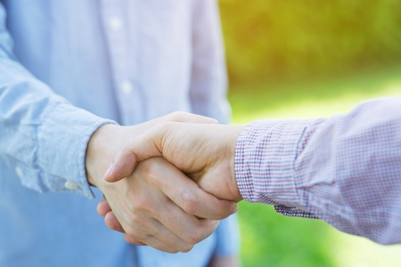 Photo for businessman hand shake between two colleagues Plaid shirt. or Negotiate agreement.Good deal. Close-up of handshaking. Smooth business. congratulations - Royalty Free Image