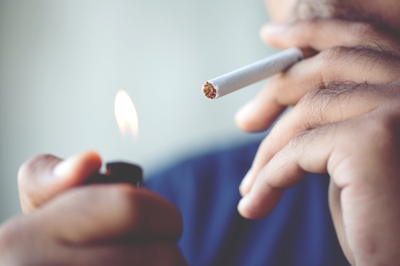 Photo for man smoking a cigarette. Cigarette smoke spread. - Royalty Free Image