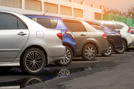 Foto de Cars parked in the parking lot.Open space area Outdoors. - Imagen libre de derechos