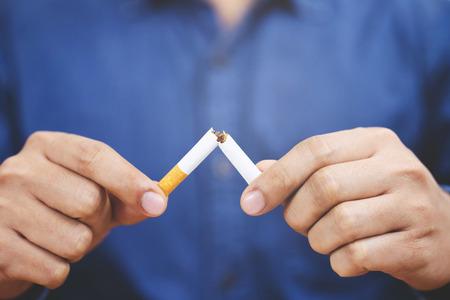 Photo pour Man refusing cigarettes concept for quitting smoking and healthy lifestyle.or No smoking campaign Concept. - image libre de droit