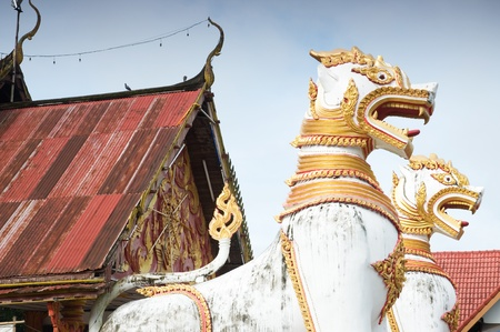 animals in mythology in front of Thai temple Kanchaburi Thailand