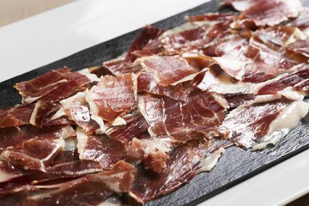 Plate of a iberian ham, Pata Negra, on a modern plate.